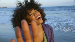 Portrait of woman at beach - stock footage