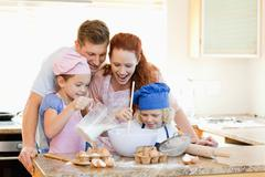 Stock Photo of Family having a great time baking together