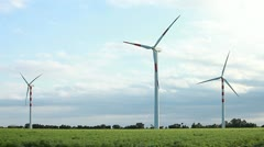 Wind turbines on green prairie - renewable energy source Stock Footage