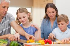 Stock Photo of Lovely family cooking together