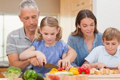 Stock Photo of Charming family cooking together