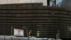 BROOKLYN, NY - FEBRUARY 15, 2012:  Workers construct the Barclays Center in Stock Footage