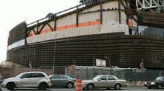 BROOKLYN, NY - FEBRUARY 15, 2012:  Busy traffic goes by the construction of the Stock Footage