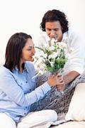 Stock Photo of Woman getting a bouquet by her boyfriend