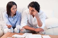 Couple talking about financial problems Stock Photos