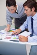 Business team working on sales statistic - stock photo