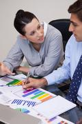 Business team talking about statistics - stock photo