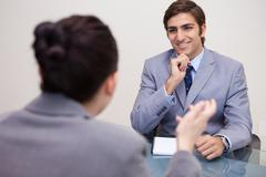 Stock Photo of Smiling businessman in a negotiation