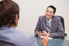 Smiling businesswoman in a meeting - stock photo
