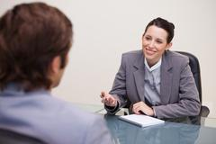 Stock Photo of Smiling businesswoman in a negotiation