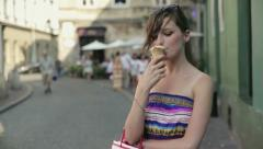 Happy woman eating ice cream in the city HD Stock Footage