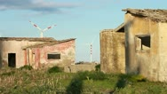 Abandoned house with wind turbine on background Stock Footage