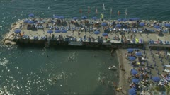 Santa Marinella (near Sorrento) beach bathers (3) Stock Footage