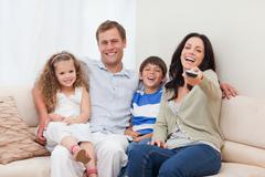 Family watching comedy together - stock photo