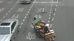 Old woman with his luggage on Henan South Road, Shanghai, China Stock Footage