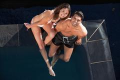 Stock Photo of Above view of a smiling couple posing