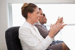 Side view of employees giving applause Stock Photos