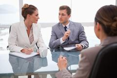 Business team deliberating with lawyer - stock photo