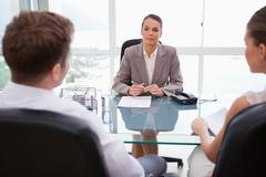 Lawyer advising her clients - stock photo
