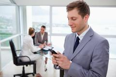 Sales manager writing text message Stock Photos