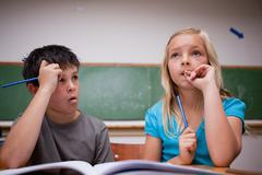 Thoughtful children working together - stock photo