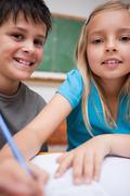 Portrait of two children writing - stock photo