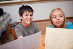Stock Photo of Pupils receiving their school report