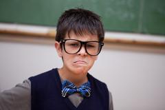 Grumpy schoolboy posing Stock Photos