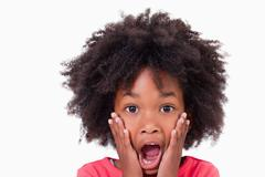 Close up of a shocked girl - stock photo