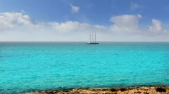Balearic formentera island near Ibiza sailboat sailing far away in horizon Stock Footage