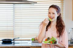 Girl having healthy salad - stock photo