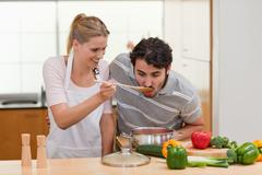 Stock Photo of Charming couple preparing a sauce