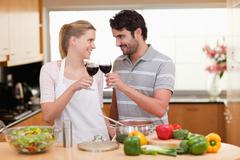Lovely couple drinking a glass of wine - stock photo