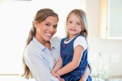 Stock Photo of Mother and her daughter posing
