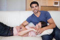 Stock Photo of Woman sleeping while his boyfriend is posing