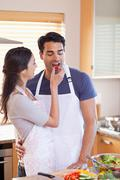 Stock Photo of Portrait a woman feeding her husband
