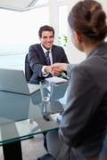 Portrait of a manager interviewing a female applicant - stock photo