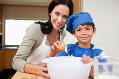 Stock Photo of Mother and son baking cake