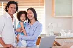 Stock Photo of Family surfing the web in the kitchen together