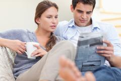 Stock Photo of Couple reading the news