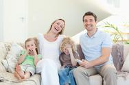 Stock Photo of Family laughing on the sofa
