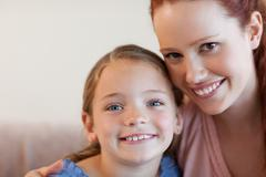 Stock Photo of Cheerful mother and daughter