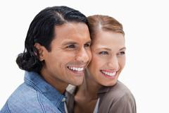 Stock Photo of Close together standing couple looking to the right