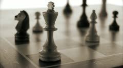 Chessmen on a chessboard - stock footage