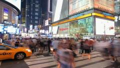Crowd of people walking at night in New York City Times Square Timelapse - stock footage