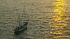Anchored sailing boat at sunset Stock Footage