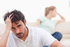 Sad couple mad at each other - stock photo
