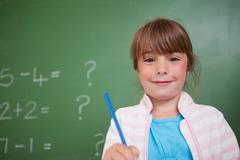 Stock Photo of Cute girl holding a pen