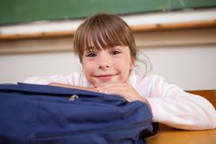 Stock Photo of Cute schoolgirl posing with a bag