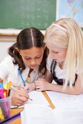Portrait of pupils working together on an assignment - stock photo